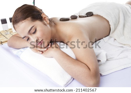Hot basalt stones applied to woman's back.