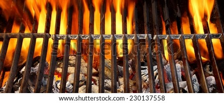Hot BBQ Grill with Bright Flame - stock photo