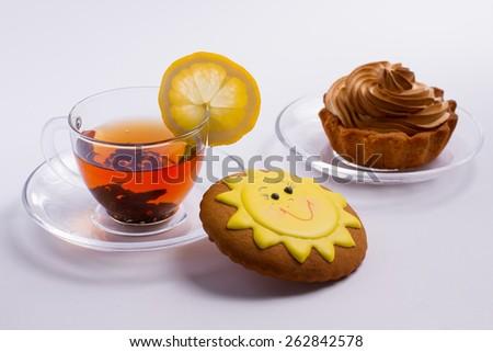 Hot black tea with delicious desserts. - stock photo