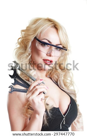 hot blond busty woman with wrenches or spanners against a white background