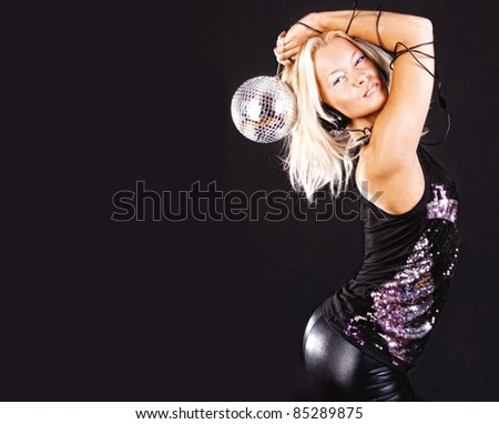 Hot blonde with disco ball dancing at party - stock photo