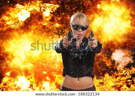 Hot blonde woman with gun over exploding background - stock photo