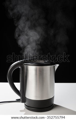 Hot boiling kettle letting out some steam