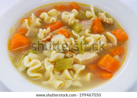 Hot bowl of chicken noodle soup. - stock photo