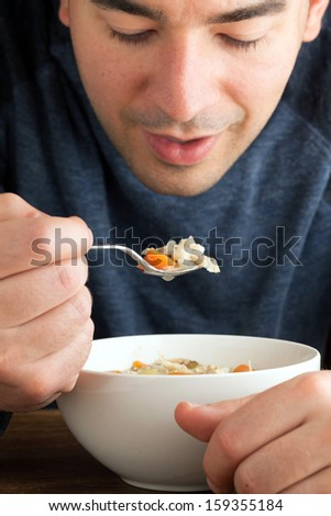 Hot bowl of fresh homemade traditional chicken soup. - stock photo