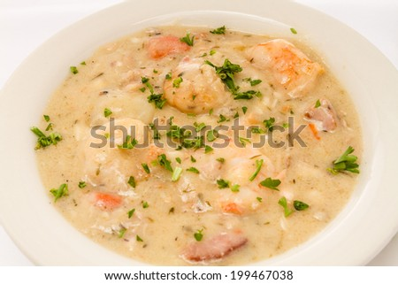 Hot bowl of seafood chowder. - stock photo