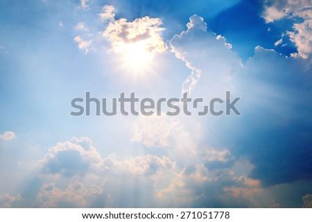 Hot bright sun over cloudy sky - stock photo