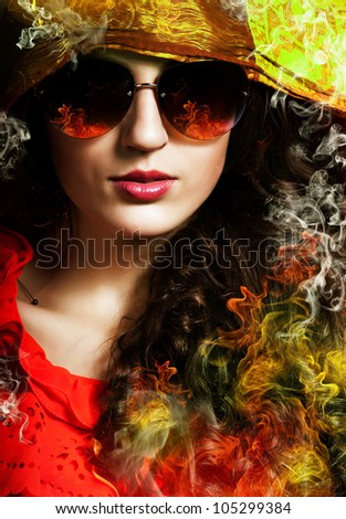 hot brunette woman in sunglasses with fire