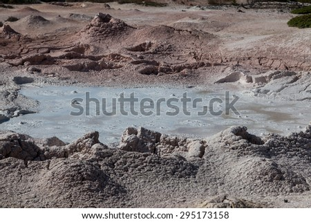 Hot bubbling mud and dried clay in the Fountain Paint Pots area of Yellowstone National Park. - stock photo