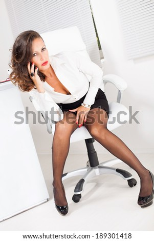 Sexy Business Woman Sitting On Office Stock Photo 186805013