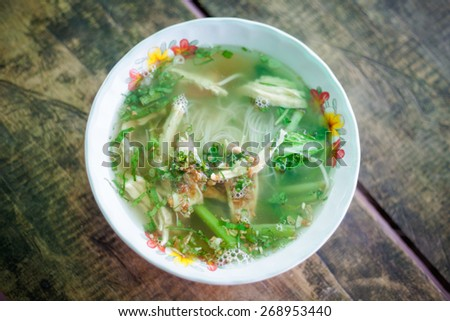 Hot cambodian broth glass noodles. Traditional khmer style soup. - stock photo