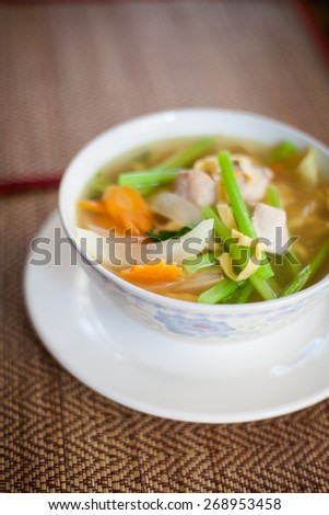 Hot cambodian broth with fish and vegetables. Traditional khmer style soup.