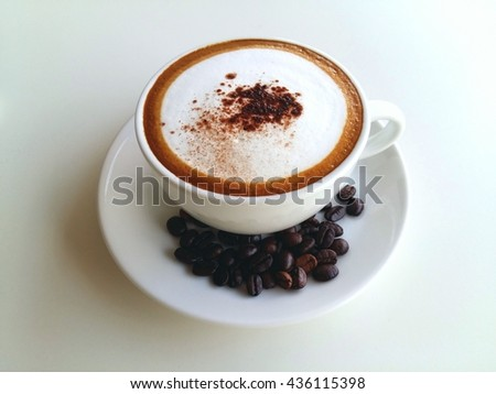 Hot cappuccino coffee with coffee bean so delicious on white background  - stock photo