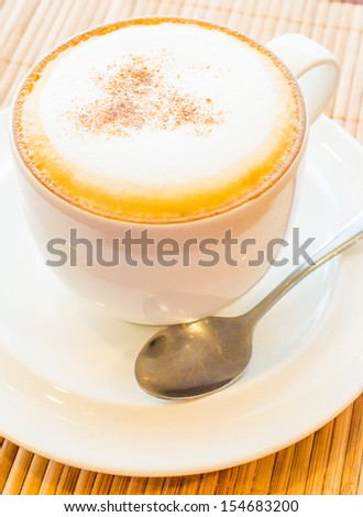 Hot cappuccino in white cup - stock photo