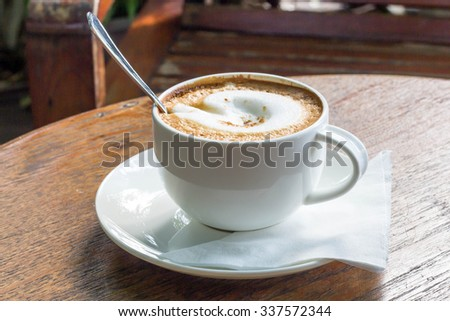 Hot cappuccino on the table