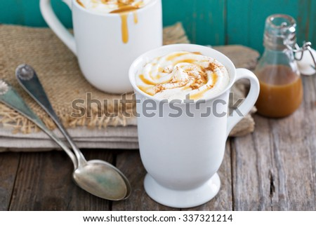 Hot caramel coffee drink with whipped cream - stock photo