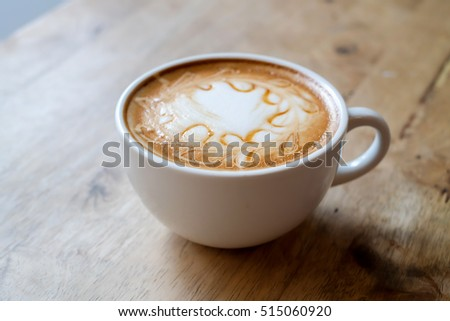Hot caramel coffee on wooden table