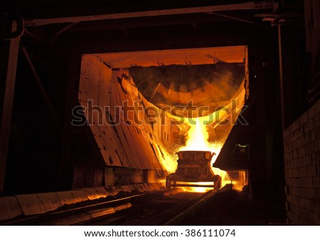 Hot casting of steel at the metallurgical plant - stock photo