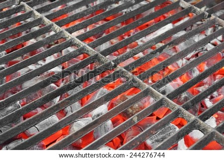 Hot Charcoal BBQ Grill with Glowing Coals Close-up - stock photo