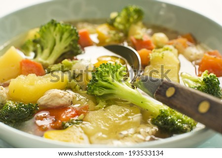 Hot chicken stew with vegetables close up - stock photo
