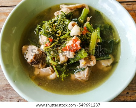 Hot chicken with vegetables soup Thai's food on wood table backgrounds