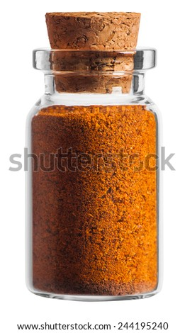 Hot chilli pepper spice in a little bottle isolated on white background - stock photo