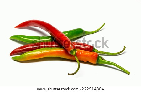 hot chilli peppers isolated on white background - stock photo