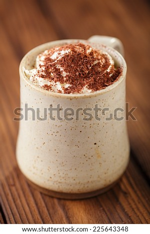 hot chocolat vintage mug, topping with cream and grated chocolate, shallow dof - stock photo