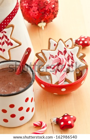 Hot chocolate and colorful decorated christmas cookies - stock photo