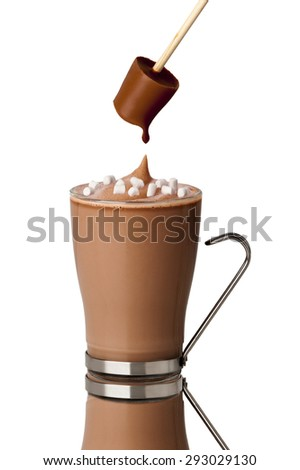 hot chocolate drink with marshmallows made with a chocolate stirrer  - stock photo