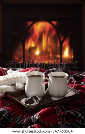 Hot chocolate drinks by the fireside - stock photo
