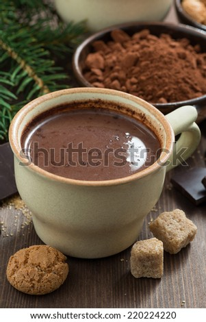 hot chocolate in a ceramic cup and amaretti cookies, vertical - stock photo