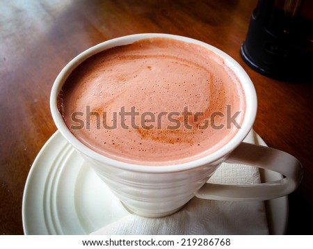 Hot Chocolate in a mug on the table - stock photo