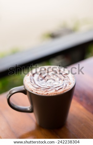 Hot Chocolate in a mug on wooden table , side view - stock photo