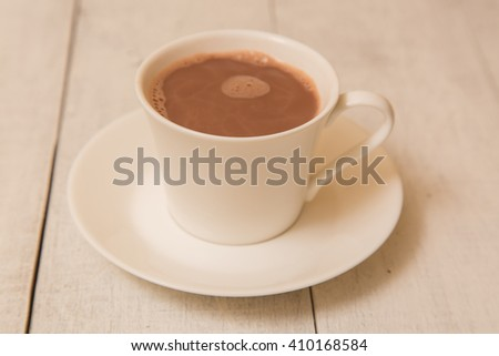 Hot Chocolate in a white ceramic mug on a white table. - stock photo