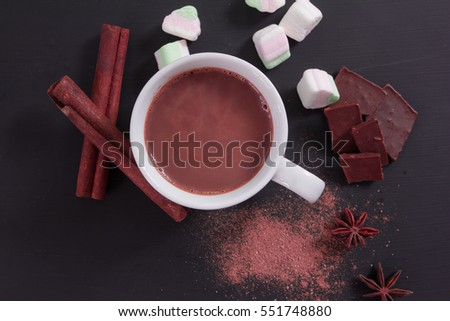 Hot chocolate in a white cup on black background, Top view