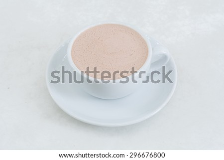 Hot chocolate in a white cup on table