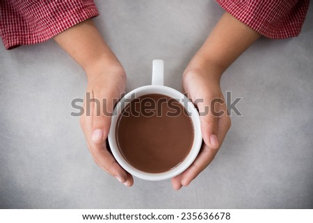 hot chocolate in girl hand - stock photo