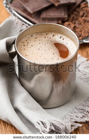 Hot chocolate with foam in a tin mug closeup - stock photo