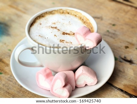 Hot chocolate with heart pink marshmallow for valentine's day - stock photo