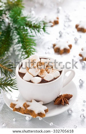 hot chocolate with marshmallows and gingerbread cookie, vertical, close-up - stock photo