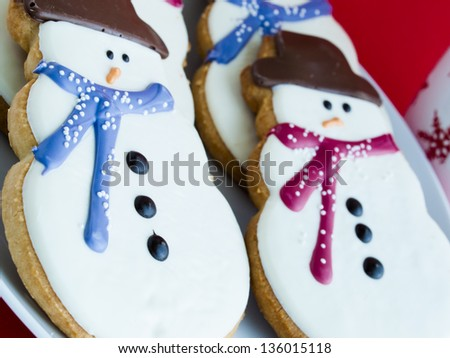 Hot chocolate with peppermint canes and snowman sugar cookies.