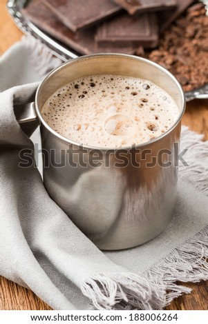 Hot chocolate with thick foam in a tin mug - stock photo