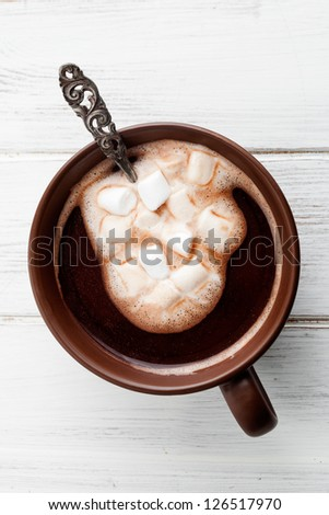 Hot chocolate with white marsmallows, selective focus - stock photo