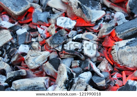 Hot coals for barbecue in the background. - stock photo