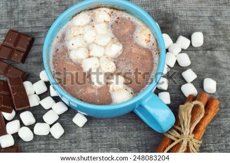 hot cocoa with marshmallows,milk, and chocolate,cinnamon sticks,chocolate - stock photo