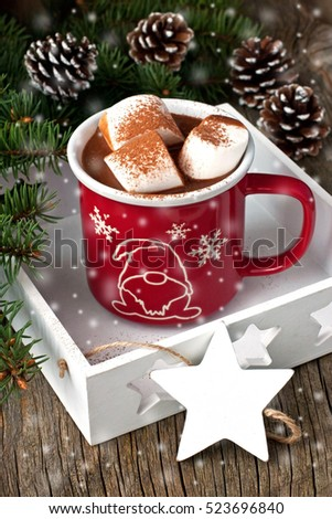 Hot cocoa with marshmallows on the wooden background. Christmas concept