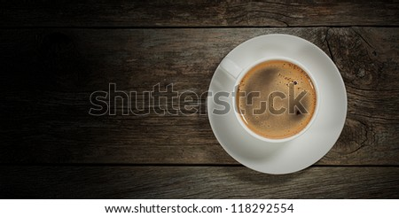 hot coffee cup on wooden table on brown background - stock photo
