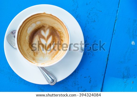 Hot coffee from top view on blue wooden table,white cup,spoon - stock photo
