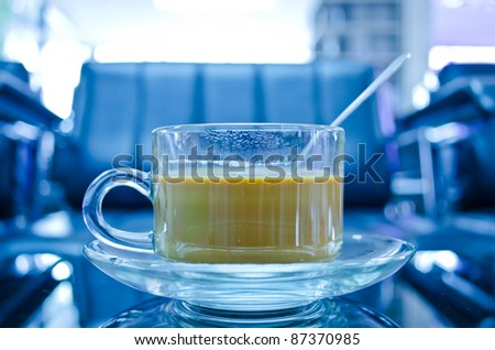hot coffee in glass cup with plate